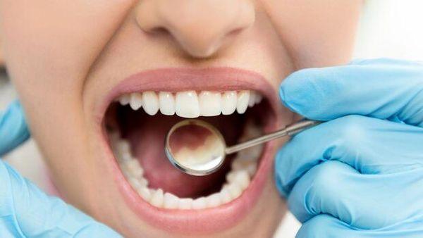 چه زمانی دندان ها را جراحی کنیم